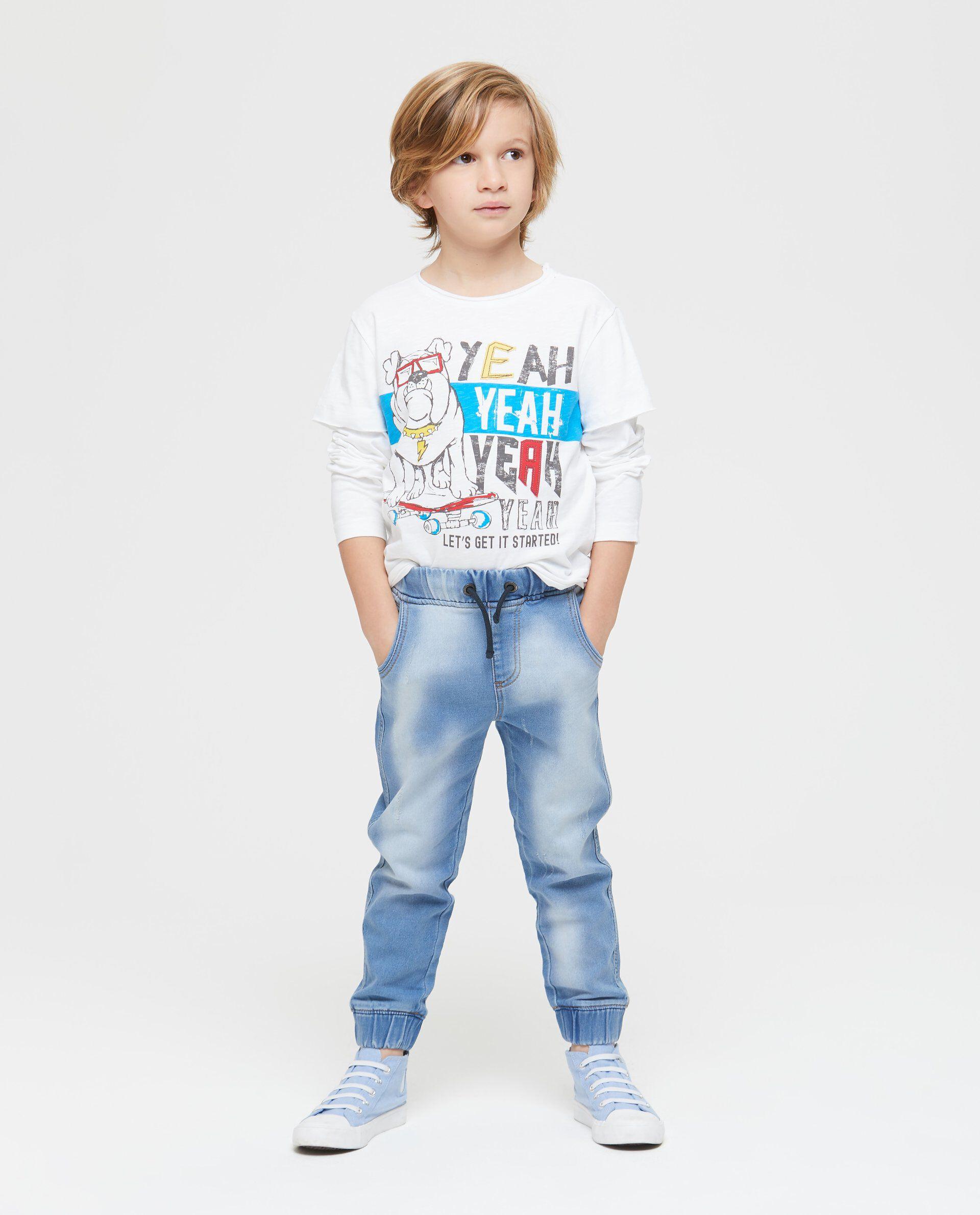 Jeans effetto delavato vita elasticata