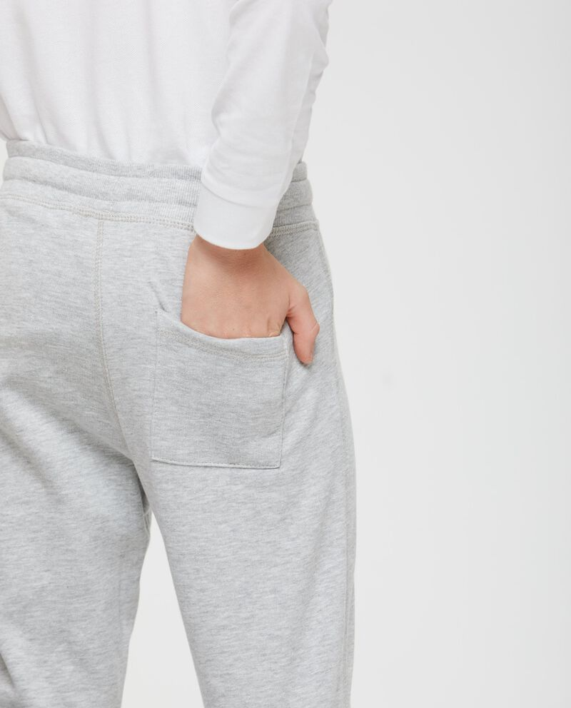 Pantaloni tinta unita stampa alle caviglie
